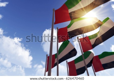 UAE flags waving in the wind against a blue sky. 3D Rendering