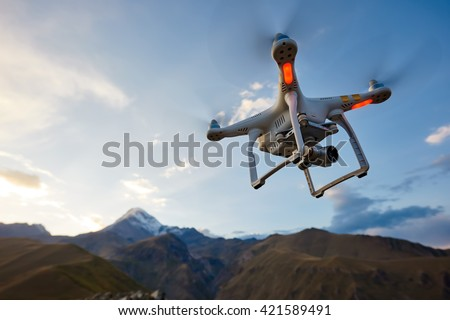 Shutterstock uav drone copter flying with digital camera