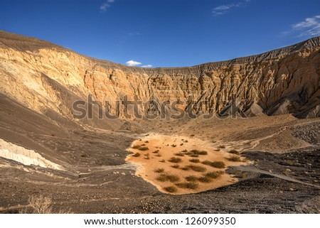 Ubehebe Crater, north tip of the Cottonwood Mountains, Death Valley. The crater is half a mile wide and 500 to 777 feet deep. The age of the crater is estimated from 2,000 to 7,000 years old.