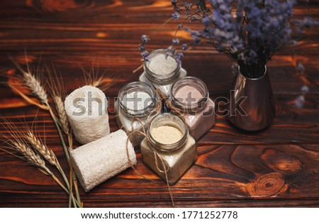 Ubtan ayurvedic. Herbal organic ubtan in glass bottle with dried lavender flowers on wooden background. Traditional natural herbal cosmetic agent for skin. Eco living. Zero waste bathroom concept