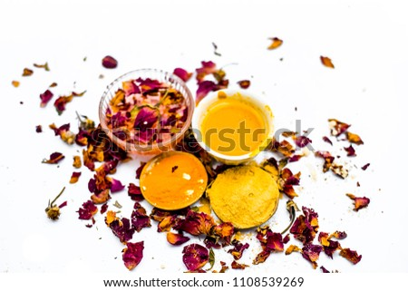 Ubtan or face pack of turmeirc powder and gram flour with and mulpani mitti isolated on white. #1108539269