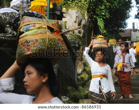 UBUD, BALI, INDONESIA - APRIL 06:  Unidentified local women wearing in traditional indonesian clothes take part in Buda Wage Kelawu ceremony at Hindu temple on April 06, 2011 in Ubud, Indonesia.