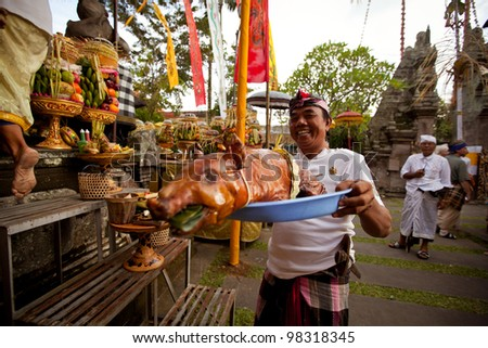 UBUD, BALI - MARCH 18: Unidentified people during performed Melasti Ritual before Balinese Day of Silence on March 18, 2012 in Ubud, Bali, Indonesia. It is a day of silence, fasting, and meditation.
