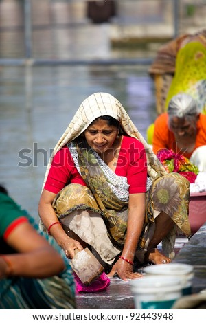 UDAIPUR, INDIA - JANUARY 25: Unidentified Indian woman washing clothes