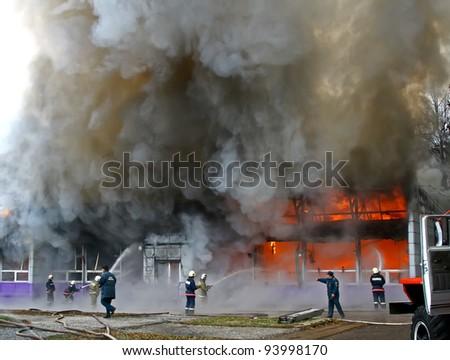 "UFA, BASHKORTOSTAN, RUSSIA - NOVEMBER 3: Bistro ""Violet smog"" burns with black smoke and heavy flames on November 3, 2010 in Ufa, Bashkortostan, Russia."