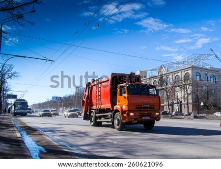 UFA/BASHKORTOSTAN - RUSSIA 13th March 2015 - A red powerful Kamaz industrial vehicle moves along an urban street #260621096