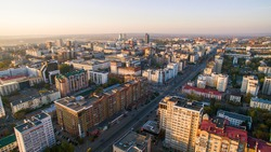 Ufa city at sunset in center. Aerial view