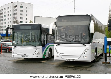 UFA, RUSSIA - MAY 11: Coach NEFAZ 52999 (VDL Mistral) and city bus NEFAZ 52998 (VDL Transit) exhibited at the annual Motor show \