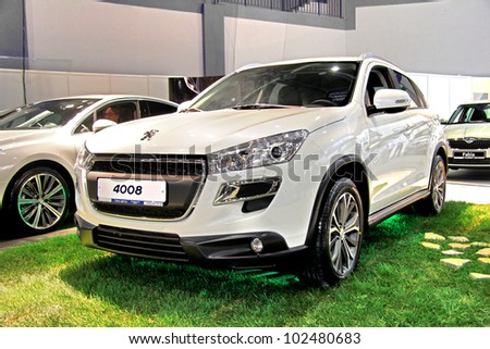"UFA, RUSSIA - MAY 14: French motor car Peugeot 4008 on display at the annual Motor show ""Autosalon"" on May 14, 2012 in Ufa, Bashkortostan, Russia."