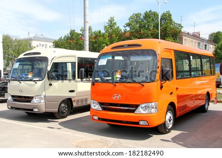 UFA, RUSSIA - MAY 23, 2012: Two Hyundai County small city buses at the city street.
