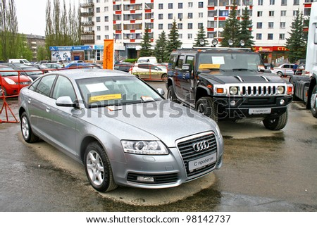"""UFA, RUSSIA - MAY 11: Used cars Audi A6 and Hummer H2 exhibited at the annual Motor show """"Autosalon"""" on May 11, 2011 in Ufa, Bashkortostan, Russia."""
