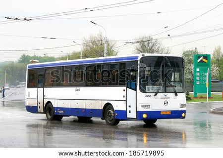 UFA, RUSSIA - MAY 15, 2009: White and blue GOLAZ-LIAZ 5256 interurban coach at the city street.