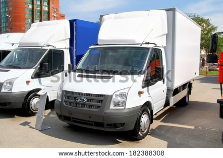 UFA, RUSSIA - MAY 15, 2012: White Ford Transit light cargo van at the city street. #182388308