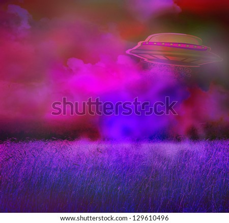 UFO over a crop field on a dark sky