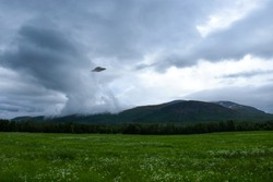 UFO over Khibiny Mountains on the Kola Peninsula in Russia. Flying saucer UFO is landing in the Khibins near Kirovsk city, Murmansk Oblast