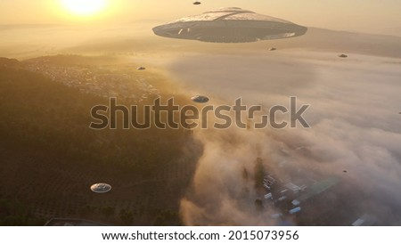 ufo's Armada fleet heading toward mother ship,aerial view  drone view from Golan Heights Israel, Alien concept   Foto stock ©
