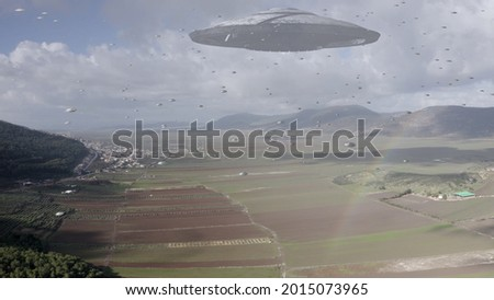 ufo's Armada fleet heading toward mother ship,aerial view  Flying saucer over Canyon, Golan Heights Israel, Alien concept  Foto stock ©