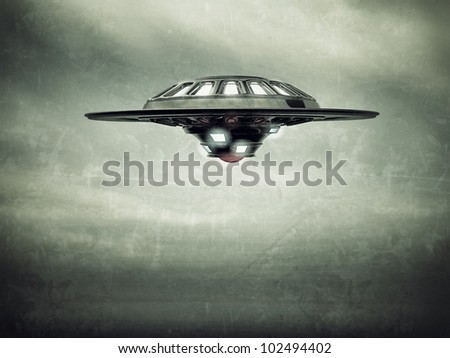 ufo spaceship vessel flying in cloudy sky
