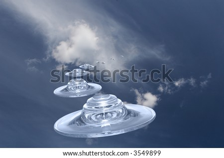 UFOs with reflections on a surface on a background of the dark blue sky with clouds