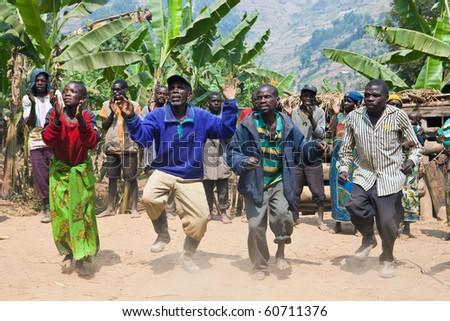 UGANDA - AUGUST 22: Pygmy  of ethnic dancing, the Pygmies of Uganda live in villages practically held in Kabale district, August 22, 2010 in Kabale, Uganda - stock photo