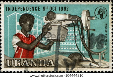 UGANDA - CIRCA 1962: A stamp printed in Uganda shows Doctor makes an X-ray in  Mulago Hospital, circa 1962