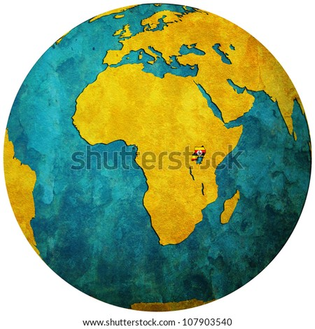 uganda territory with flag on map of globe