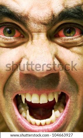 Ugly and furious zombie portrait.Vampire portrait.Horror vampire portrait.