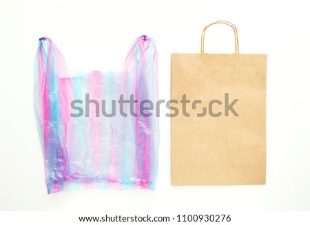Ugly colorful plastic bag vs brown recyclable eco paper bag. Reduce, Reuse and Recycle concept. Flat lay, view from above, isolated on white