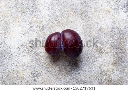 Ugly plums. Abnormal organic conjoined fruit #1502719631