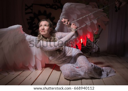 05d952f76 Ugly woman in a white dress with white wings is trying to look as angel #