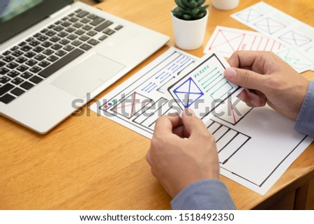 UI Graphic designer creative sketch and planning prototype wireframe for website. Web application development of user interface and user experience concept #1518492350