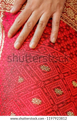 """Uis Gara or Uis Adat Karo or  """"Kain Merah"""" is a customary clothing used in indigenous and cultural activities of the Karo Tribe of North Sumatra, Indonesia. #1197923812"""