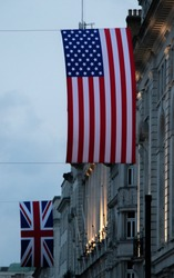 UK and US flag in London at Piccadilly Circus