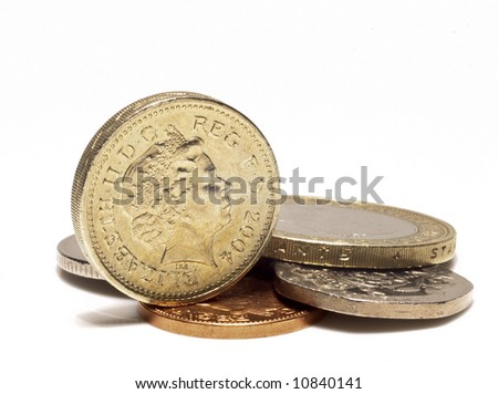 UK coins on white background with shadow