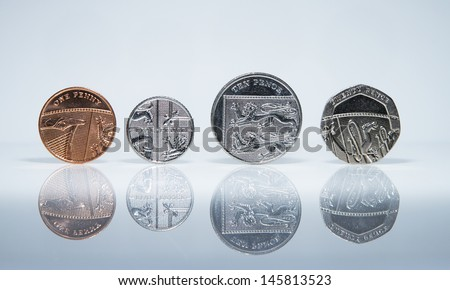 UK Currency Coins balanced in a row