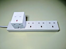 UK extension cord for British plugs and outlets. With a three-way extension plugged in.