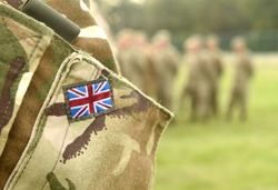UK flag on soldiers arm. UK military uniform. United Kingdom troops