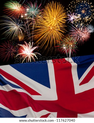 UK Holiday concept with fireworks and waving UK flag .