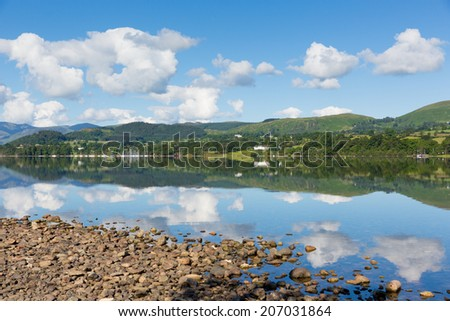 UK Lake District Ullswater Cumbria England with mountains and blue sky on beautiful still summer day with water reflections from sunny weather