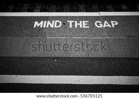UK 'Mind the gap' sign on train platform
