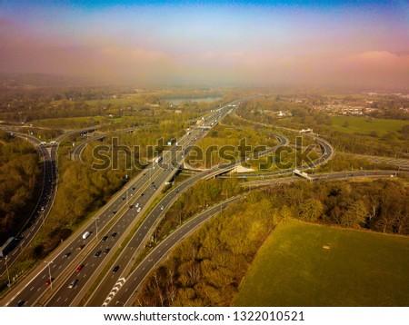 UK Motorway Junction - M3 M25 Aerial View. Busy road with traffic jam #1322010521