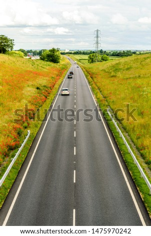 uk motorway road overhead view at daylight #1475970242