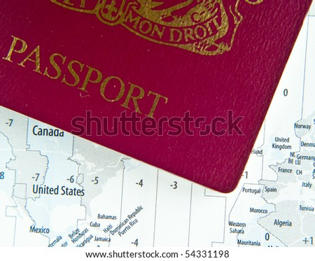 world map uk. stock photo : UK passport on world map with time zones