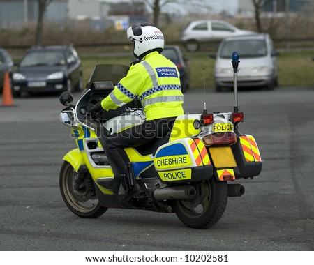 Uk police motorcycle rider - stock photo