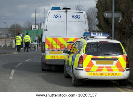 Uk police vehicles at the scene of a public disturbance