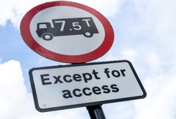 UK Road Sign explaining that trucks weighing more than 7.5 tonnes are prohibited in a certain area unless it is solely for access purposes.