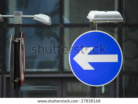 UK road traffic direction sign on urban road - stock photo