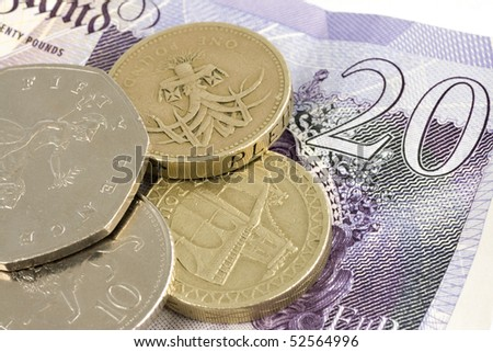 Uk sterling money notes and coins - stock photo