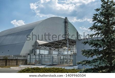 Ukraine, Chernobyl - August 19, 2017: Arch under the fourth power unit of Chernobyl NPP #1409960504