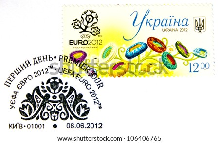 """UKRAINE - CIRCA 2012: A stamp printed in Ukraine shows image of football stadiums in form of flowers and a postage stamp cancellations """"Euro 2012, First Day"""" from series """"UEFA EURO 2012"""", circa 2012 - stock photo"""